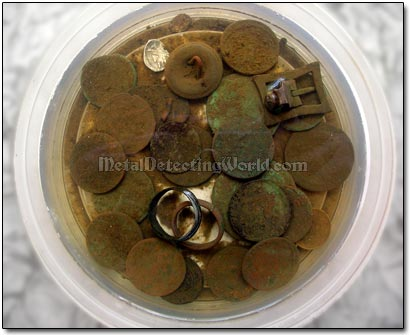 Soaking Dug Coins in Warm Soapy Water
