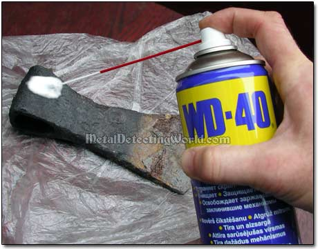 Spraying WD-40 onto Derusted Half to Prevent Rerusting