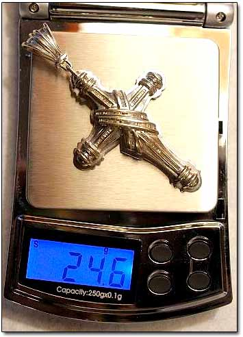 Gold Crucifix on Weight Scale