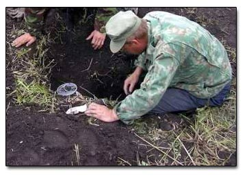 Eyeballing Single Coins In a Prospecting Hole