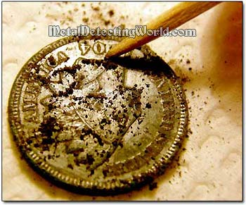 Removing Dirt Off the Coin