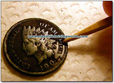 Toothpick Coin Cleaning