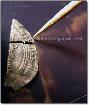 Use A Toothpick To Arrange Coin Fragments On Clear Tape Before Lamination - Step 9
