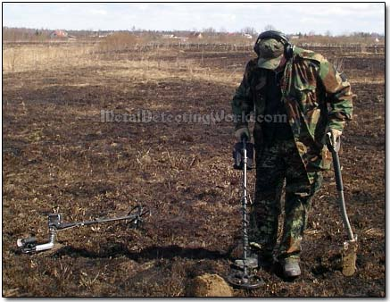 Metal Detecting on Burnt Grass Field